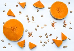 Pulp, slices of pumpkin, seeds on white background