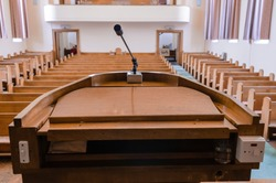 Pulpit at the a church with wooden pews