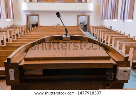 Pulpit at the a church with wooden pews Zdjęcia stock ©