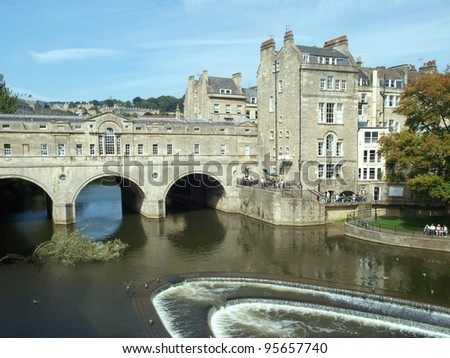 Pulteney Bridge (designed by Robert Adam) over the River Avon in Bath, Somerset, England and showing an adjacent weir