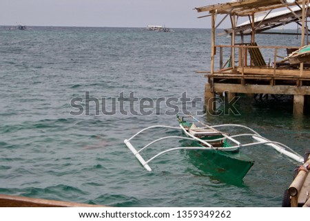 Pump boat tied to dock in Cebu, Philippines  #1359349262