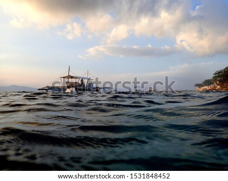 Pump boats on the sea at sunset in Moalboal, Cebu, Phillipines #1531848452