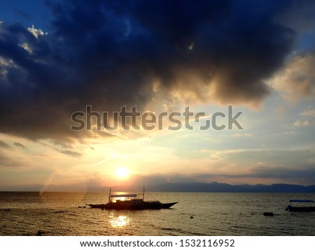 Pump boats on the sea at sunset in Moalboal, Cebu, Phillipines #1532116952