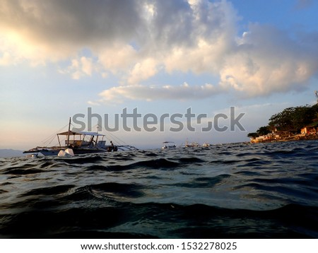 Pump boats on the sea at sunset in Moalboal, Cebu, Phillipines #1532278025