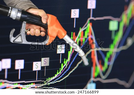 pump nozzle and stock chart of gas and oil business growth prize graph data for investment analysis economic background.  news