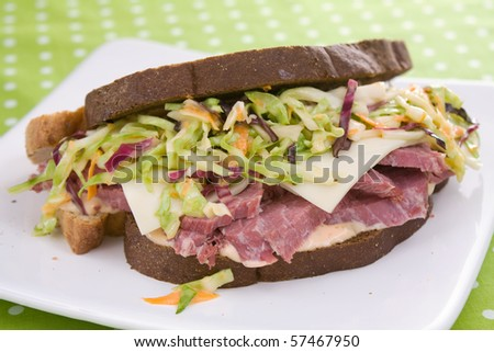 Pumpernickel rye bread filled with thick slices of corned beef, creamy coleslaw, swiss cheese, and thousand island dressing.