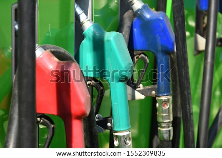 Pumping gas in row at station