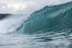 Pumping Surf; a perfect left hand wave peels and tubes, ideal conditions for surfing and what surfers dream of