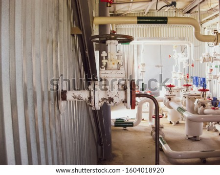 Pumping water pumping. Hand valve on the pipe. Oil refinery. Equipment for primary oil refining.