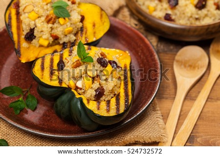 Pumpkin Acorn Stuffed with Quinoa, Nuts and Dried Fruit. Selective focus. #524732572