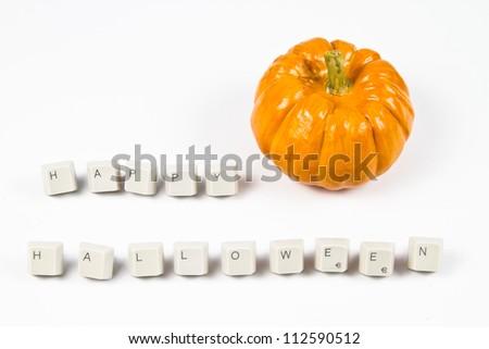 Pumpkin and happy halloween text