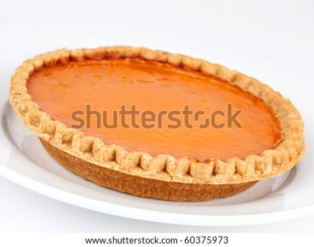 Pumpkin and sweet potato pie on white background