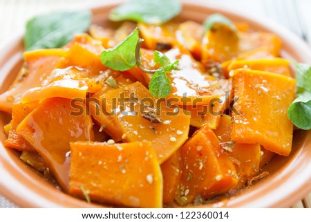 pumpkin baked with honey sauce on the plate