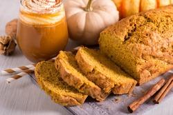 Pumpkin bread cake with pumpkin spice latte for autumn fall dinner