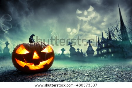 Pumpkin Burning In A Graveyard With Ghost Nightmare