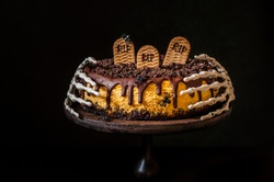 Pumpkin Cheesecake with Festive Halloween Decoration, RIP, Spiders, Skeleton Hands