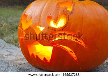 Pumpkin cut in a shape of a cat