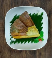 Pumpkin Egg Custard wtih Coconut Milk Steamed Thai Dessert delicious dish decorate carved spring onion little flower topview