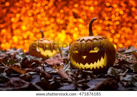 Pumpkin for Halloween, lamp pumpkin, antique wood, celebrating halloween, smiley on a pumpkin, autumn dry leaves, bright background, funny and angry face