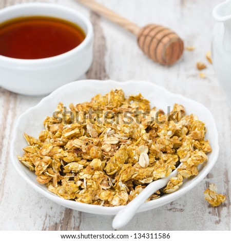 pumpkin granola and honey  in a bowl