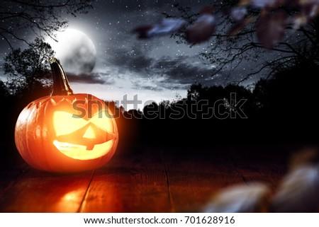 Pumpkin Halloween in a dark, dangerous environment #701628916