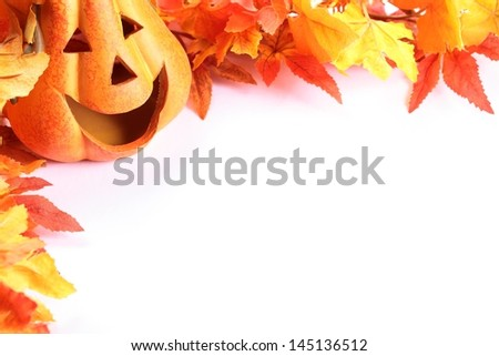Pumpkin head and colorful leaves on white background with copy space.