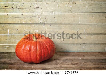 pumpkin on old wooden floor