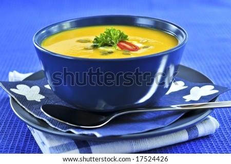 Pumpkin or squash soup in a bowl