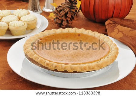 Pumpkin pie and tarts on a Halloween or Thanksgiving dinner table