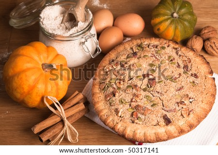Pumpkin pie decorated with pecan nuts and walnuts