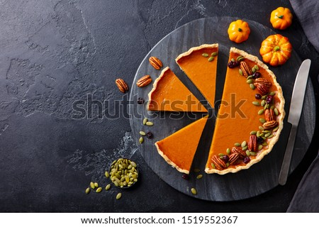 Pumpkin pie on marble cutting board. Dark background. Copy space. Top view. Сток-фото ©