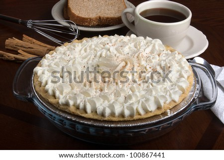 pumpkin pie / Pumpkin pie topped with whip cream and cinnamon.
