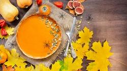 Pumpkin pie. Traditional American pie. Autumn theme. Halloween food. Thanksgiving Day. Dark wooden background. Copy space.