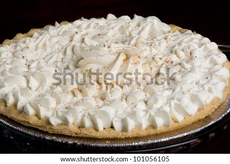 pumpkin pie/ traditional pumpkin pie topped with whip cream and cinnamon.