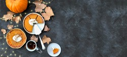 Pumpkin pies flat lay and lights twinkling.