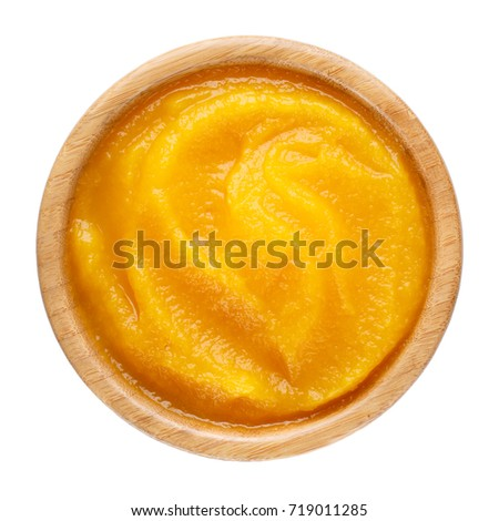 Pumpkin puree in wooden bowl isolated on white background. Top view #719011285