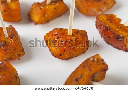 Pumpkin roasted with herbs and spices and served as appetizers.