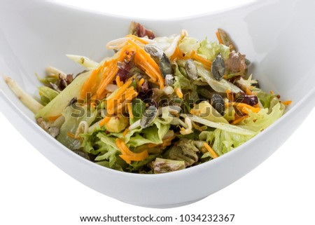 Pumpkin salad with seeds and avocados. Vegetarian dish. On white background #1034232367