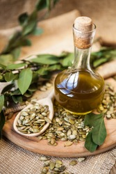 Pumpkin seed oil in a glass bottle with seeds