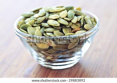 Pumpkin seeds close up in glass bowl