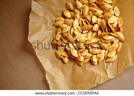 Pumpkin seeds, grilled, lightly oiled and seasoned using paprika and sea salt.