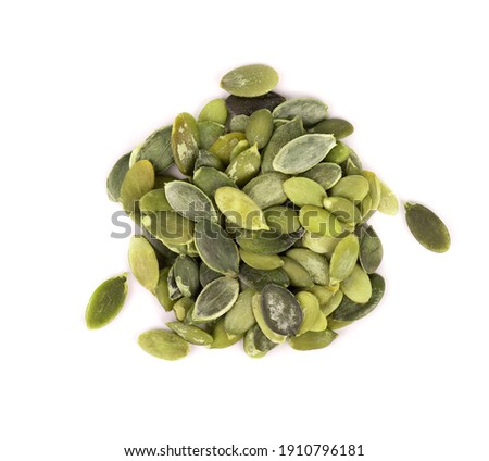 Pumpkin seeds isolated on white background. Green pepita seeds. Top view. Foto stock ©