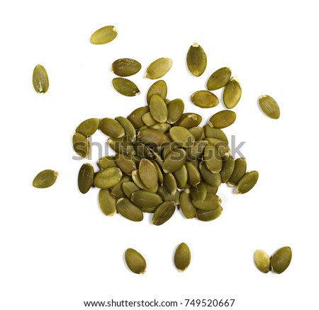 Pumpkin seeds isolated on white background, top view #749520667