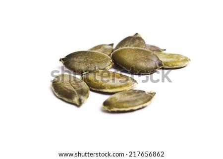 Pumpkin seeds on a white background