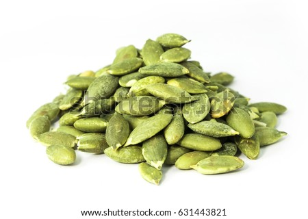Pumpkin seeds on a white background #631443821