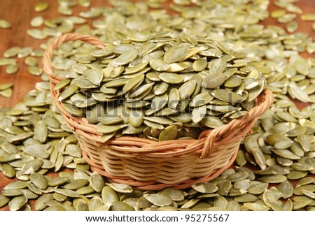 Pumpkin seeds on the table - stock photo