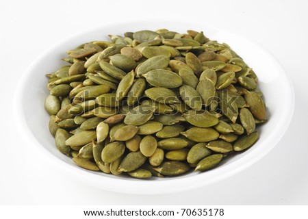 pumpkin seeds on white dish