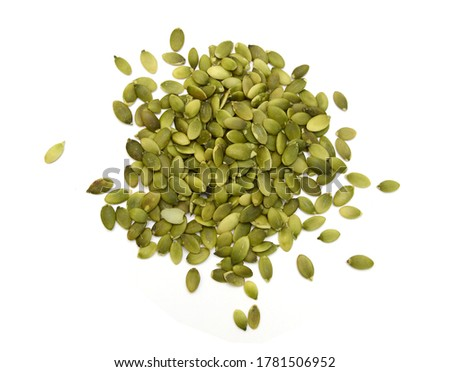 Pumpkin seeds or pepitas, isolated on white background. Overhead view. - Image  Foto stock ©