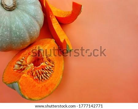 Pumpkin slice (gourd, squash) on orange lava lush color background, copy space. Pumpkin or gourd whole & squash slice modern trend fall background, top view. Composition pumpkin, squash gourd mockup Foto stock ©