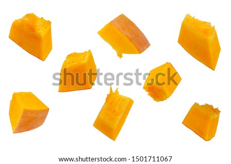 Pumpkin slices isolated on a white background, top view. Sliced pumpkin isolated on white. Pieces of pumpkin, top view. Diced pumpkin, closeup.